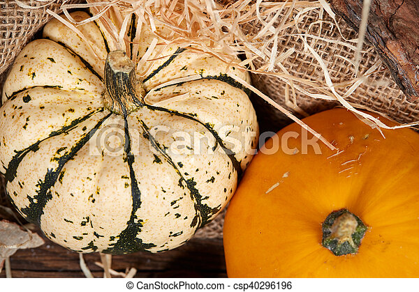 Top view of table with pumpkin and straw - csp40296196