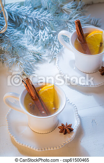 Top view of tea with cinnamon and orange for Christmas - csp61500465