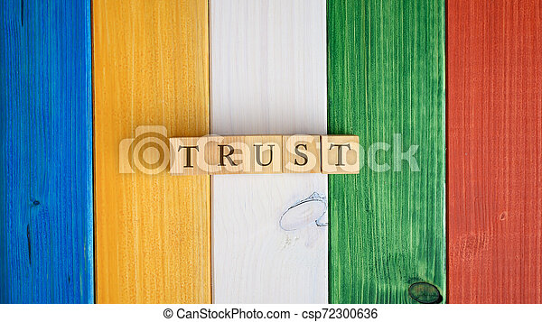 Top view of the word Trust spelled on wooden cubes - csp72300636