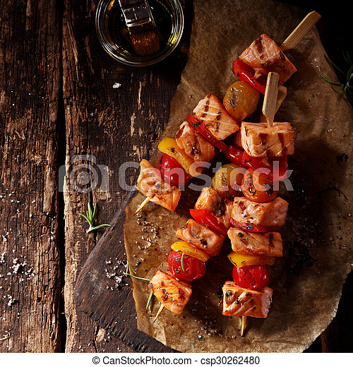 Top View of Three Fish Kebabs on Table with Oil - csp30262480