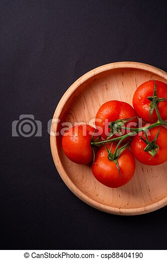 top view of tomatoes in a wooden plate - csp88404190