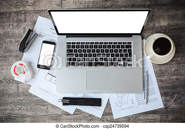 top view of work place with laptop and documents - csp24739594