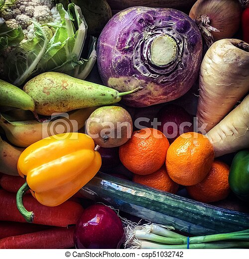 Top view on a tray of seasonal fruit and vegetables - csp51032742
