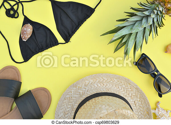 top view on beach accessories on yellow background- summer vacation concept - csp69803629