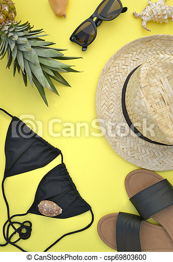 top view on beach accessories on yellow background- summer vacation concept - csp69803600