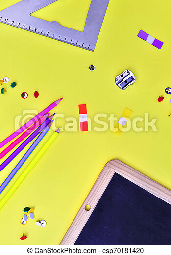 top view on suplies of school on yellow background - csp70181420