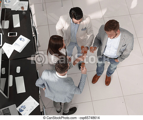 top view. the business team celebrates a successful startup - csp65748614