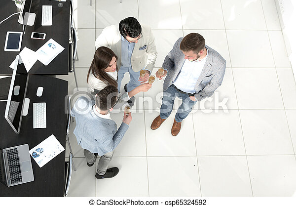 top view. the business team celebrates a successful startup - csp65324592