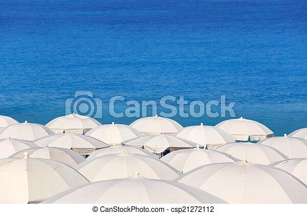 Tops of white parasols and sea Kathisma Lefkada Greece - csp21272112