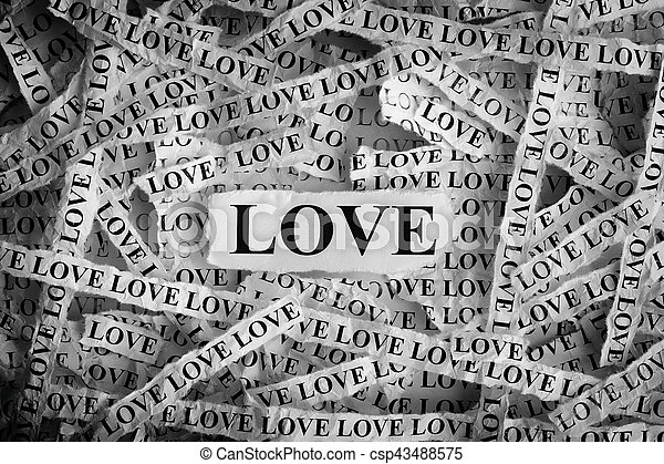 Torn pieces of paper with the word Love - csp43488575