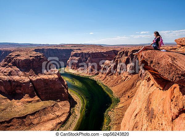 Tourist at Horseshoe Bend on Colorado River - csp56243820