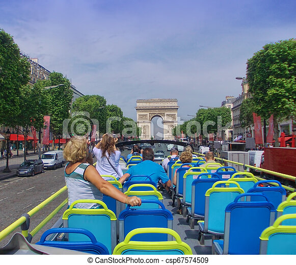 tourist bus in Paris France. Champs Elysees boulevard in summer - csp67574509