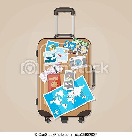 Tourist equipment on brown travel suitcase  - csp35902027