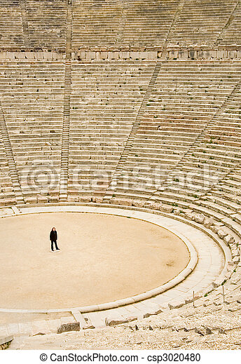 Tourist in ancient theater in Epidaurus, Greece. The theater is the largest surviving theater in Greece and marveled for its exceptional acoustics - csp3020480