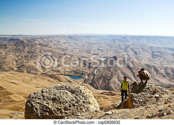 Tourist in mountain of Jordan - csp5926632