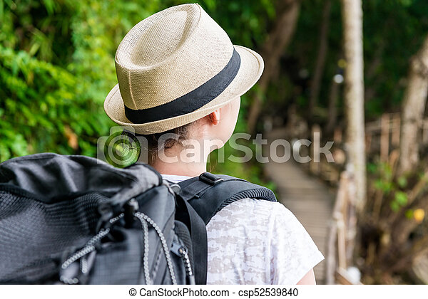 tourist on holiday with a large backpack backpack view back - csp52539840