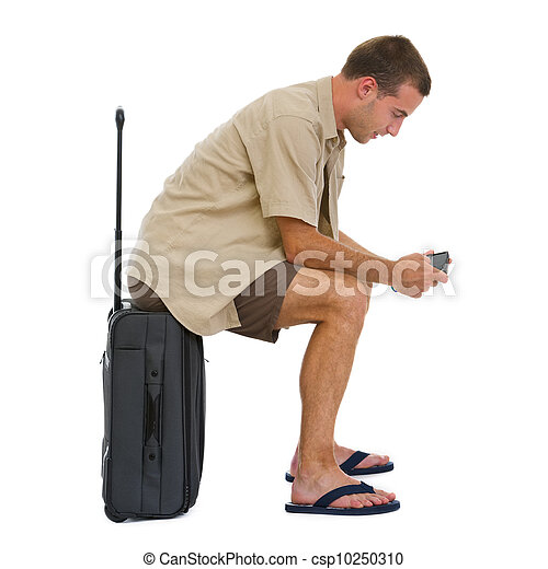 Tourist sitting on bag and checking vacation photos while waiting airplane - csp10250310