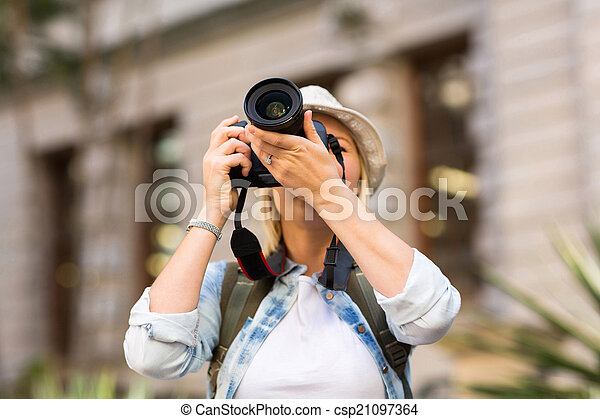 tourist taking photo in city - csp21097364