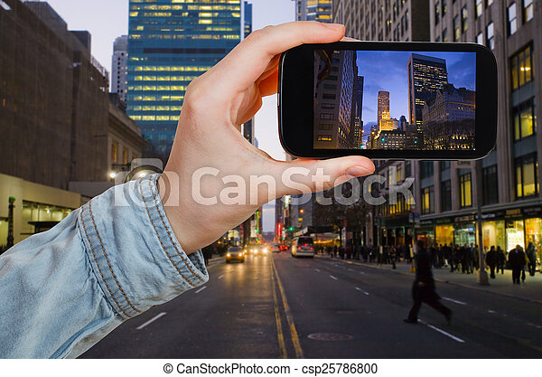tourist taking photo of New York City in night - csp25786800