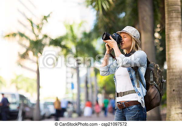 tourist taking photos in the city - csp21097572
