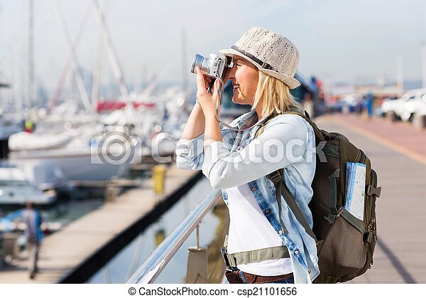 tourist taking pictures at the harbour - csp21101656