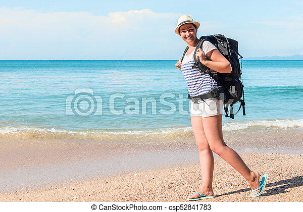 tourist with a backpack walks along the sandy beach of the resort of Thailand on a sunny day - csp52841783