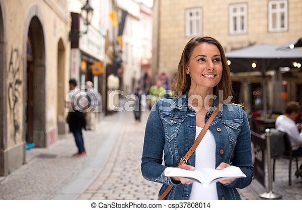 tourist with guidebook - csp37808014