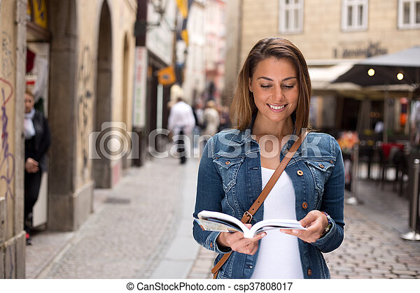 tourist with guidebook - csp37808017