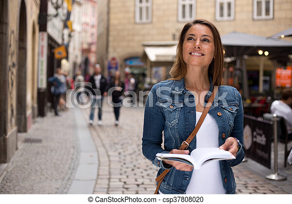 tourist with guidebook - csp37808020