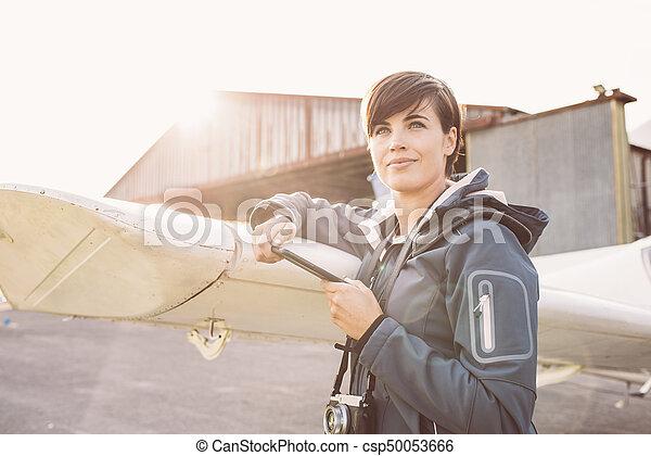 Tourist with smartphone at the aerodrome - csp50053666