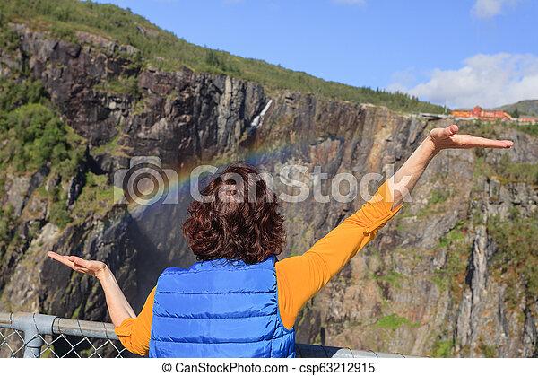 Tourist woman by Voringsfossen waterfall, Norway - csp63212915