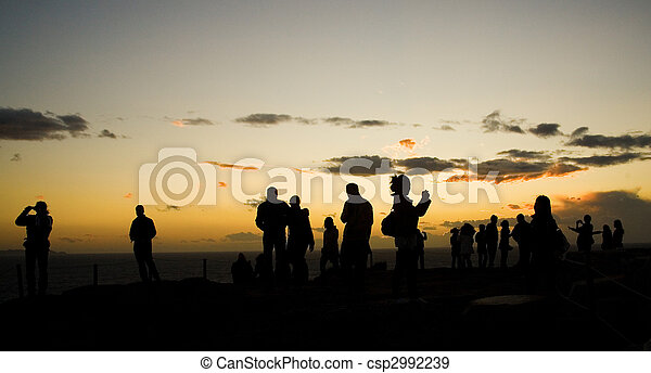 Tourists on Sounion cape in Greece at sunset, making pictures of famous Temple of Poseidon. The southernmost point of the Attica Peninsula - csp2992239