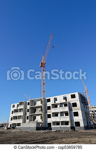 Tower crane and building on the sky background - csp53659785