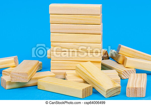 Tower of wooden blocks on blue - csp64006499