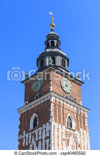 Town hall tower on main market square on blue sky background, Krakow, Poland - csp40465592