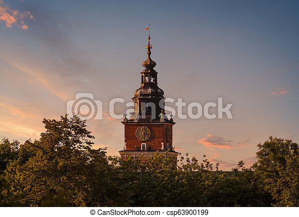 Town hall tower on the background of dramatic sky. Krakow - csp63900199