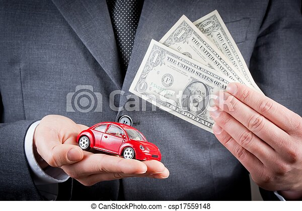 toy car and dollars in the hands of business man concept for insurance, buying, renting, fuel or service and repair costs  - csp17559148