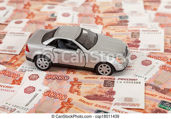 Toy car on the background of russian banknotes - csp18011439