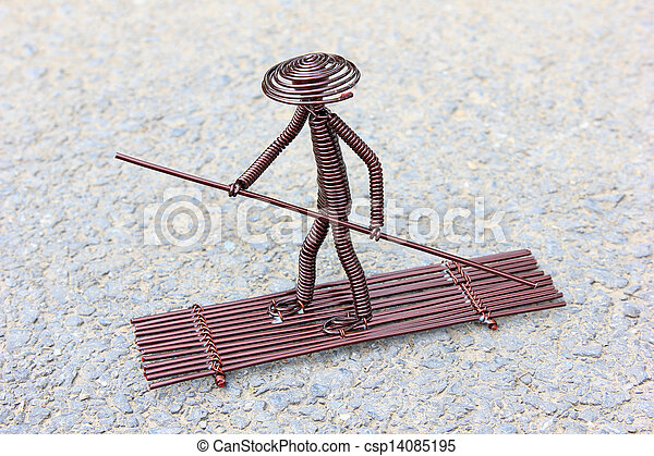 Toy crafts boatman made of copper wire on the ground stock ...