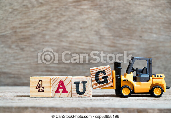 Toy forklift hold block G to complete word 4 aug on wood background (Concept for calendar date in month August) - csp58658196