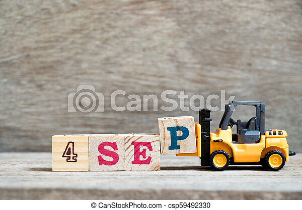 Toy forklift hold block P to complete word 4 sep on wood background (Concept for calendar date in month September) - csp59492330