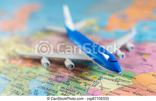 Toy of a plane on the Europe map. - csp87105333
