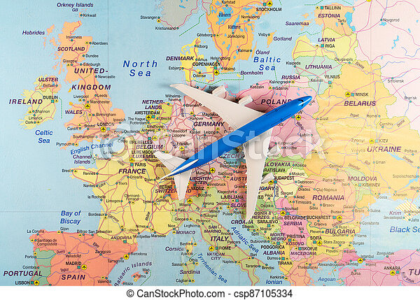 Toy of a plane on the Europe map. - csp87105334