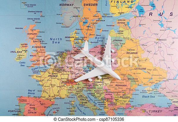 Toy of a plane on the Europe map. - csp87105336