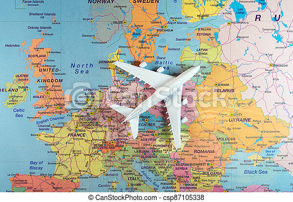 Toy of a plane on the Europe map. - csp87105338
