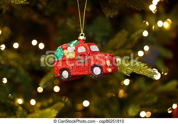 Toy red car on the Christmas tree - csp86251810