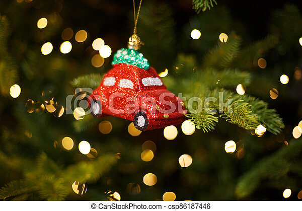 Toy red car on the Christmas tree - csp86187446