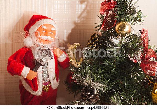 Toy Santa Claus and Christmas tree, - csp42986922