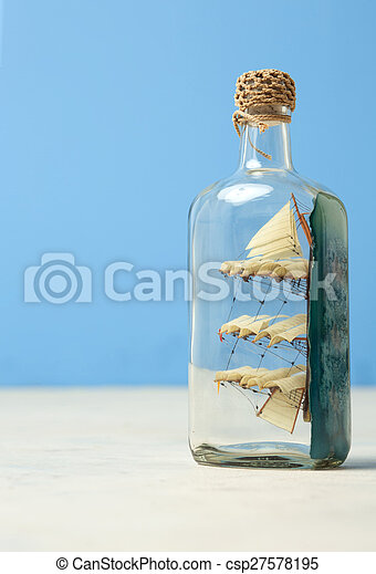 toy ship in a glass botttle - csp27578195