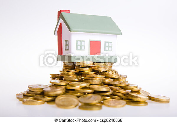 Toy small house standing on a heap of coins. - csp8248866
